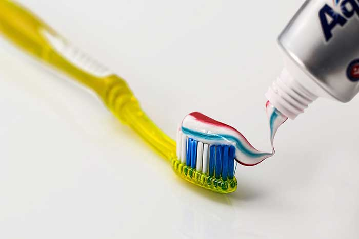 Toothpaste applied on toothbrush
